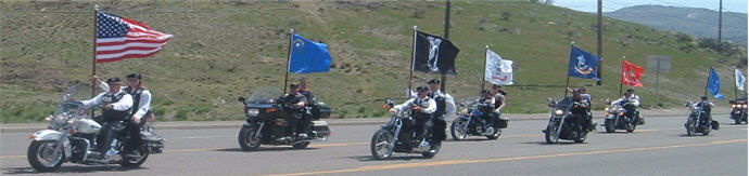 POW MIA members riding motorcycles with flags
