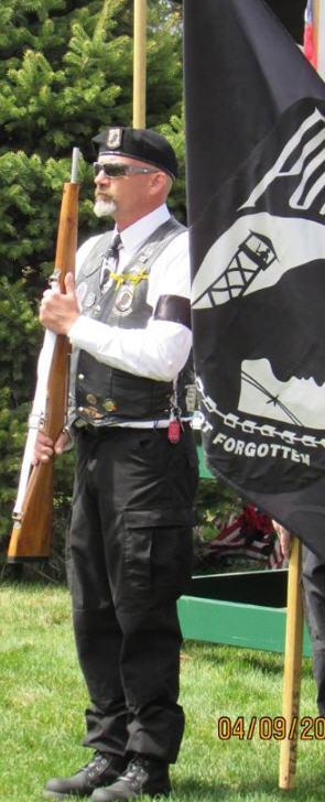 Association Member carrying ceremonial rifle